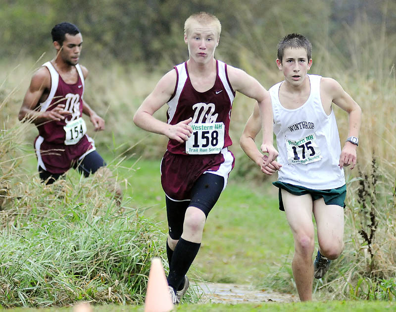Monmouth Academy's Alex Turbide, center, breaks ahead of of Winthrop High School's Mathias Deming, right, as Monmouth's Marcques Houston closes in Wednesday during a cross country meet at Monmouth Academy.
