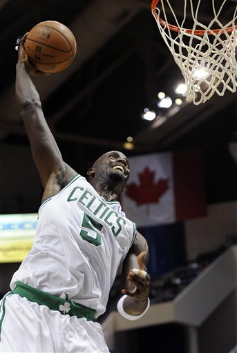 Boston Celtics' Kevin Garnett (5) approaches a slam dunk in the second half of an NBA preseason basketball game against the New York Knicks, Saturday, Oct. 13, 2012, in Hartford, Conn. New York won in overtime 98-95. (AP Photo/Jessica Hill)