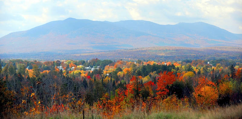 A patchwork of colors fill Carabassett Valley last week. Foliage has peaked in much of Maine, but there are still plenty of turning leaves for a worthwhile leaf-peeping road trip.