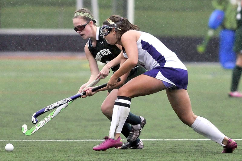 FUN IN THE RAIN: Mt. View High School's Braley Leadbetter (7) back, battles for the ball with Waterville Senior High School's Sage Duguay (4) in the first half at Thomas College in Waterville Thursday. Mt. View defeated Waterville 2-1.