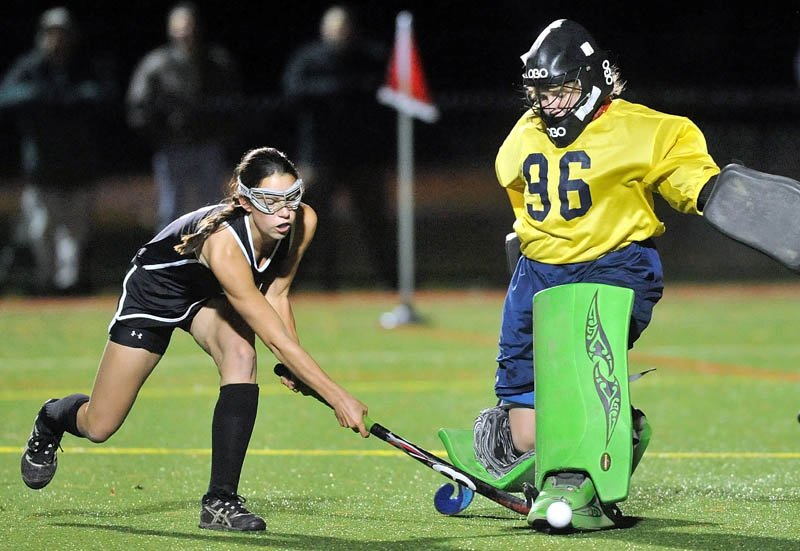 KICK SAVE: Skowhegan's Brooke Michonski, left, takes a shot on Belfast goalie Julia Ward, right, during a Kennebec Valley Athletic Conference championship game Thursday at Thomas College.