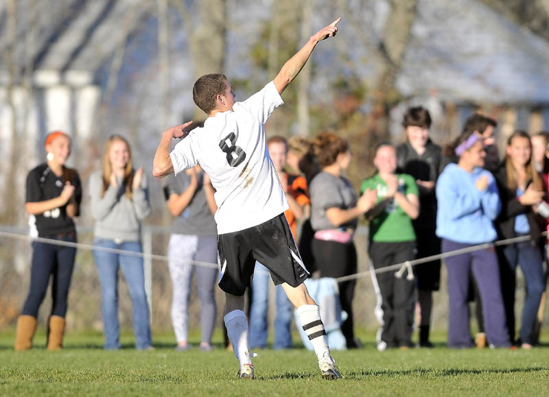 CELEBRATE: Winslow High School's Gabe Smith celebrates his goal against Oceanside High School in the second half of an Eastern B quarterfinal game Wednesday at Kennebec Savings Bank field in Winslow. Smith scored twice and Winslow defeated Oceanside 2-0.