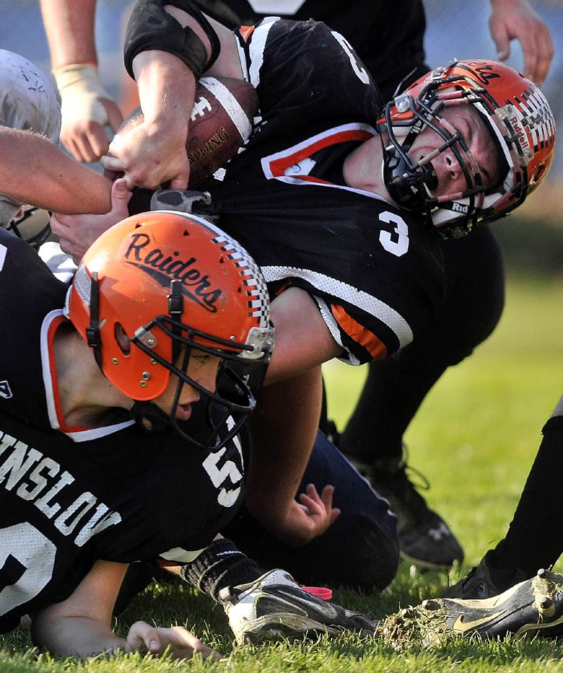 RUGGED RUN: Winslow High School running back Dylan Hapworth (3) muscles his way into the end zone during the Raiders' 50-22 win over Yarmouth in a Campbell Conference Class C quarterfinal game Saturday.