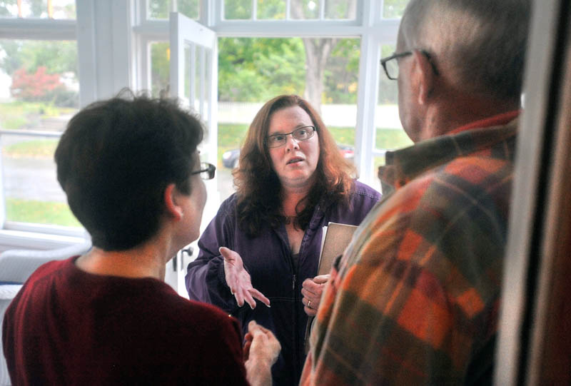 Staff photo by Michael G. Seamans Colleen Lachowicz, Democratic candidate a seat in the Maine State senate, center, speaks with Douglas Archibald, right, and Debra Campbell,left, at 43 Burleigh St in Waterville Thursday. Lachowicz is running for the seat in a Senate district encompassing part of Waterville, Winslow, Albion, Benton, Clinton, Detroit, Pittsfield and Unity Township.