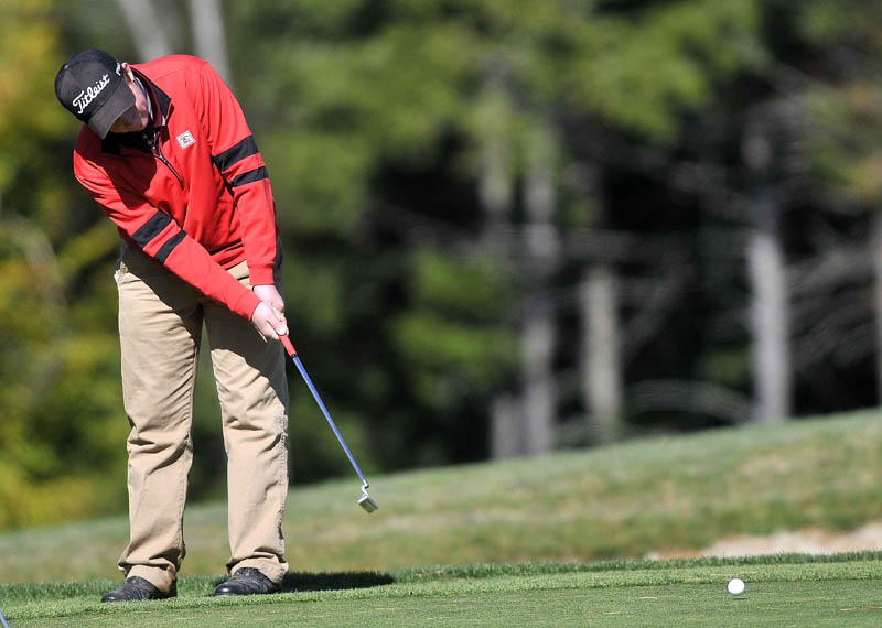ON THE GREEN: Maine Central Institute's Gavin Dugas putts on the 15th green during the individual golf state championships Saturday at Natanis Golf Course in Vassalboro. Dugas shot 80 to finish tied for sixth in Class B.