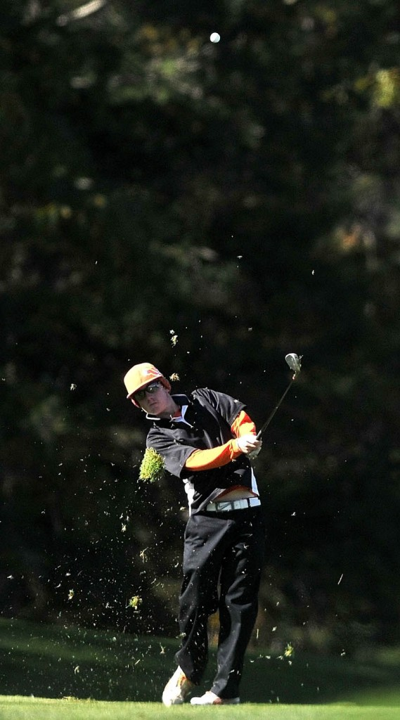 Maranacook High School's Luke Ruffing, swings for the green on the 15th hole during the High School Individual Golf Championship at Natanis Golf Course in Vassalboro on Saturday.