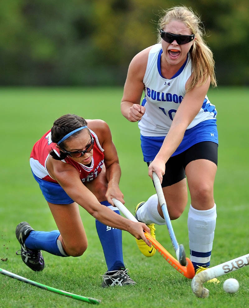 Take the shot: Messalonskee's Kristy Bernatchez, left, takes a shot on goal as Lawrence's Sasha Letourneau defends it in the first half in Fairfield Tuesday. Messalonskee defeated Lawrence 7-0.