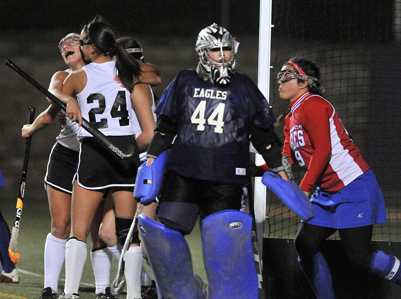Staff photo by Michael G. Seamans Skowhegan High School's Rylie Blanchet, 24, celebrates with teammates after scoring against Messalonksee High School's Abigail Roberts, 44, right center and Natalie Hunt, 19, in the second half of the Eastern Class A championship game. Skowhegan defeated Messalonskee 2-1.