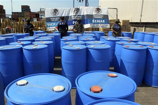 In this file photo released by the Mexican navy, Navy marines stand guard over barrels containing 120,000 kilograms of methylamine, a precursor chemical, seized at the Pacific port of Lazaro Cardenas, Mexico, that were headed for Guatemala. The meth problem is spilling into other parts of Latin America, too, almost all of it bound for Guatemala.