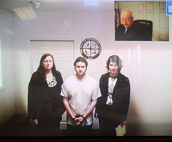 """Seth Mazzaglia, bottom center, is seen during his video arraignment from the Strafford County Jail in Dover, N.H., to the district court in Dover on Monday, Mazzaglia was charged with killing Elizabeth """"Lizzi"""" Marriott, a 19-year-old University of New Hampshire student."""