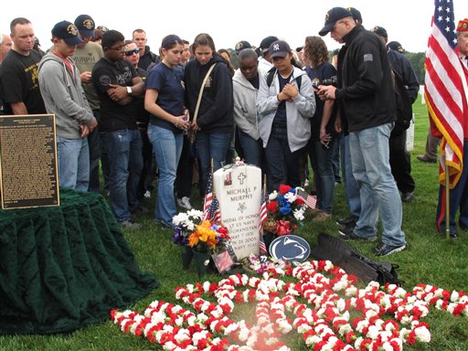 Crew members from the USS Michael Murphy gather at the gravesite of the Navy SEAL during a memorial service at Calverton National Cemetery in Calverton, N.Y. on Tuesday.