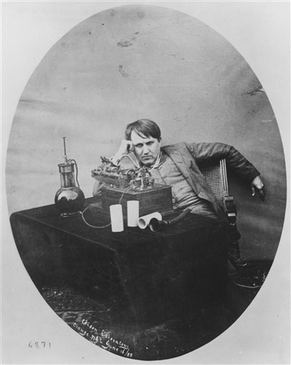 A 1888 photo of Thomas Edison listening to a wax cylinder phonograph.