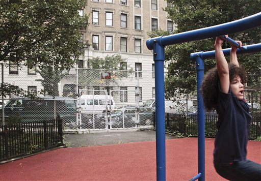 Nicholas Gayles, 6, a student at P.S. 75, plays in the school's playground across the street from a shelter on 95th Street on Oct. 3, 2012 in New York.