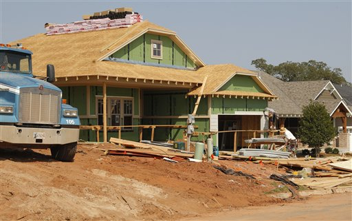 A new home is under construction recently in Edmond, Okla. The steady increase in prices, along with the lowest mortgage rates in decades, has helped many home markets slowly rebound nearly six years after the housing bubble burst.