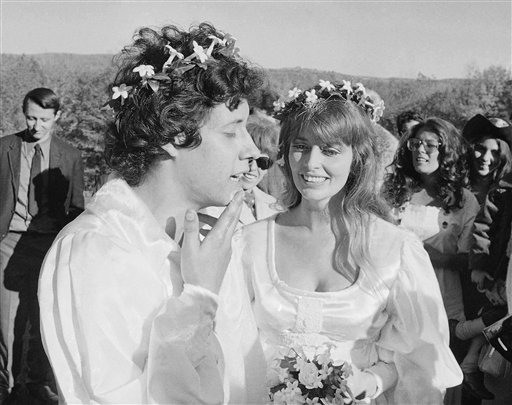 "An Oct. 9, 1969, photo of Arlo Guthrie singing ""Amazing Grace"" to his new bride Jackie Hyde, at their wedding ceremony on Guthrie's farm in Washington, Mass."