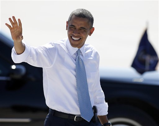 President Barack Obama waves to supporters as he arrives at McCarran International Airport in Las Vegas on Sunday. He has one mission heading into his first debate with Republican Mitt Romney: Don't screw things up.