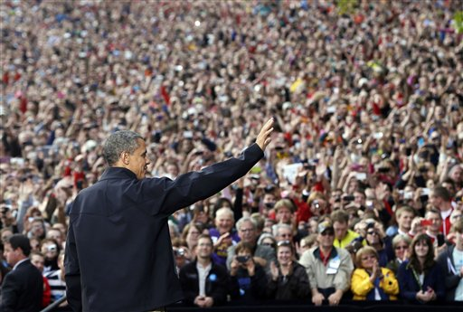 President Barack Obama waves to supporters as he takes the stage during a campaign event at the University of Wisconsin-Madison on Thursday.