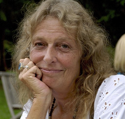 This 2011 photo released by Rising on Records shows Jackie Guthrie, wife of folk singer Arlo Guthrie in Paris. Arlo Guthrie has announced the death of his wife, Jackie, at age 68. An obituary released by Guthrie's record label says Jackie Guthrie had inoperable cancer and died Sunday, Oct. 14, 2012 at the couple's winter home in Sebastian, Fla. They had recently celebrated their 43rd wedding anniversary. (AP Photo/Rising on Records)