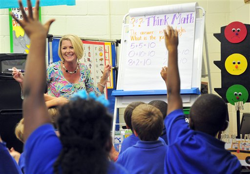 Teacher Deanna Jump quizzes her first-grade students at Central Fellowship Christian Academy in Macon, Ga., recently. Jump is the first million-dollar seller on teacherspayteachers.com, a website that teachers use to buy and sell school supplies, bulletin board designs and lesson plans.