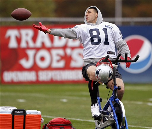 New England Patriots tight end Aaron Hernandez (81) can not hang onto the ball as he trys to catch a pass while riding a stationary bike during practice at the NFL football team's facility in Foxborough, Mass., Wednesday, Oct. 24, 2012. (AP Photo/Stephan Savoia) Gillette Stadium