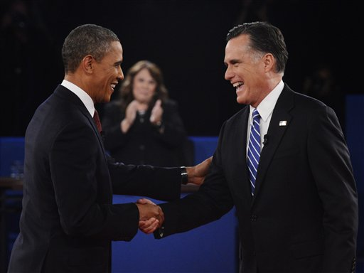 Moderator Candy Crowley, center, applauds as President Barack Obama, right, shakes hands with Republican presidential nominee Mitt Romney Tuesday during the second presidential debate at Hofstra University in Hempstead, N.Y.