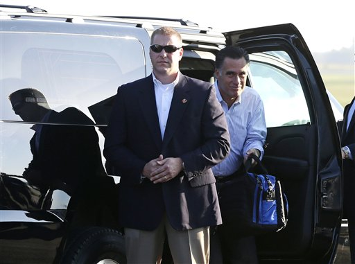 Republican presidential candidate Mitt Romney gets out of his vehicle before boarding his campaign plane at Weyers Cave-Shenandoah Valley Airport in Weyers Cave, Va., on Friday.