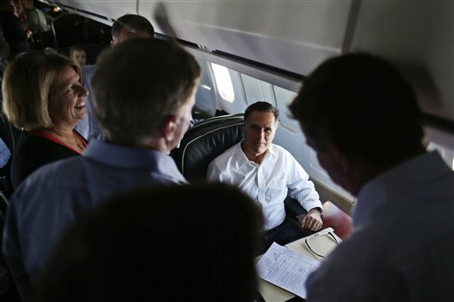 Republican presidential candidate Mitt Romney talks with senior advisers on his campaign plane en route to Denver recently.