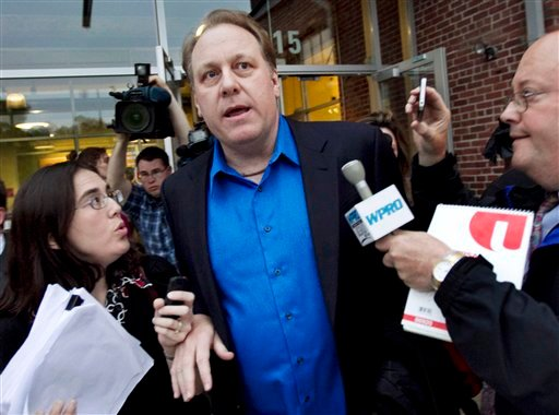 Former Boston Red Sox pitcher Curt Schilling departs the Rhode Island Economic Development Corporation headquarters in Providence, R.I., in this May 21, 2012, photo.