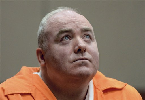 Michael Skakel listens to a statement from John Moxley, brother of victim Martha Moxley, in court in Middletown, Conn., in this Jan. 24, 2012, photo.