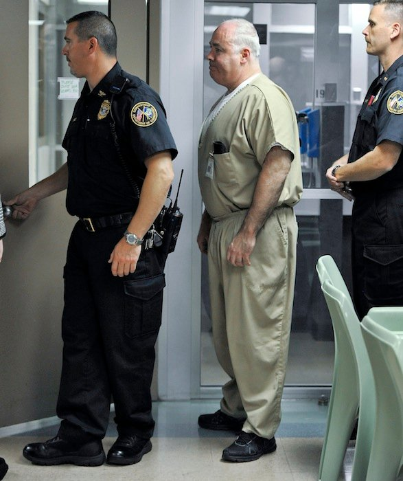 Michael Skakel, center, is brought to a holding area to await the decision of parole board during a hearing at McDougall-Walker Correctional Institution in Suffield, Conn., Wednesday, Oct. 24, 2012. Parole officials denied Skakel's first bid for parole since he was convicted a decade ago of killing his neighbor in 1975. Skakel is serving 20 years to life for fatally beating Martha Moxley with a golf club in Greenwich when they were 15-year-old neighbors. (AP Photo/Jessica Hill, Pool)