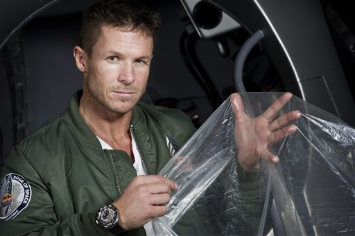 """In this Feb. 23, 2012, pilot Felix Buamgartner of Austria shows a piece of the balloon material he will use. It's described as a """"40-acre dry cleaner bag,"""" that, when first filled, will stretch 55 stories high."""