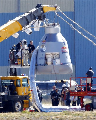 Felix Baumgartner, in pressurized suit on platform at left, prepares to enter the balloon capsule in Roswell, N.M., on Tuesday. The skydive attempt was later canceled due to high winds.