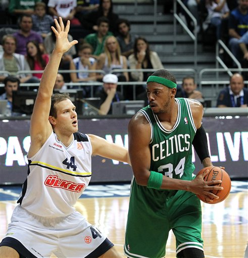 Boston Celtics' Paul Pierce (34) goes for a basket against Fenerbahce Ulker's bojan Bogdanovic, Bogdanovic (44) and David Andersen during an exhibition basketball game in Istanbul, Turkey, Friday, Oct. 5, 2012.(AP Photo/TURKPIX)