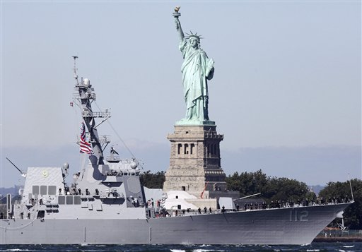 The USS Michael Murphy powers past the Statue of Liberty as it heads into New York Harbor on Monday in New York.