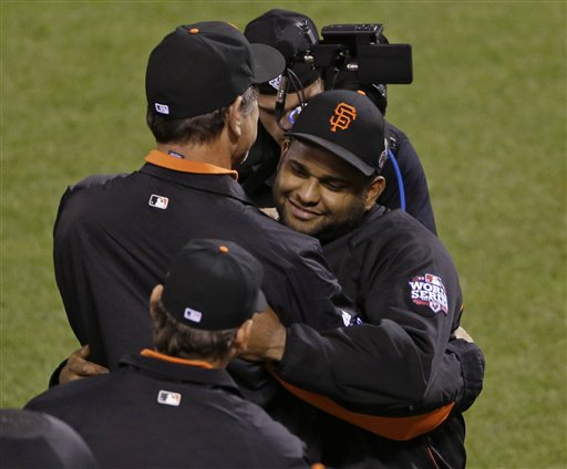 San Francisco Giants' Pablo Sandoval, right, is congratulated by manager Bruce Bochy after the Giants defeated the Detroit Tigers, 8-3, in Game 1 of the World Series on Wednesday in San Francisco. MLB