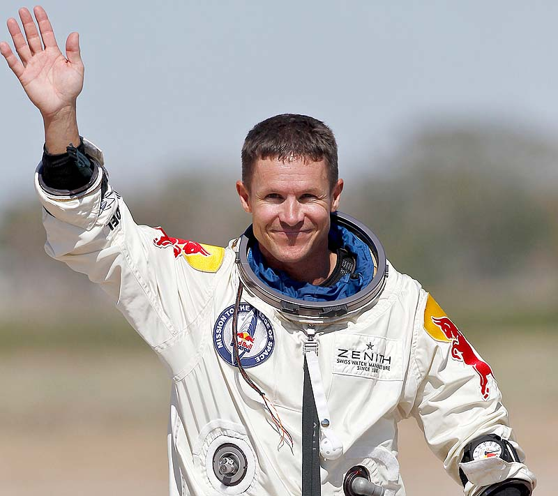Felix Baumgartner waves to the crowd after successfully jumping from a space capsule lifted by a helium balloon at a height of just over 128,000 feet above the Earth's surface on Sunday.