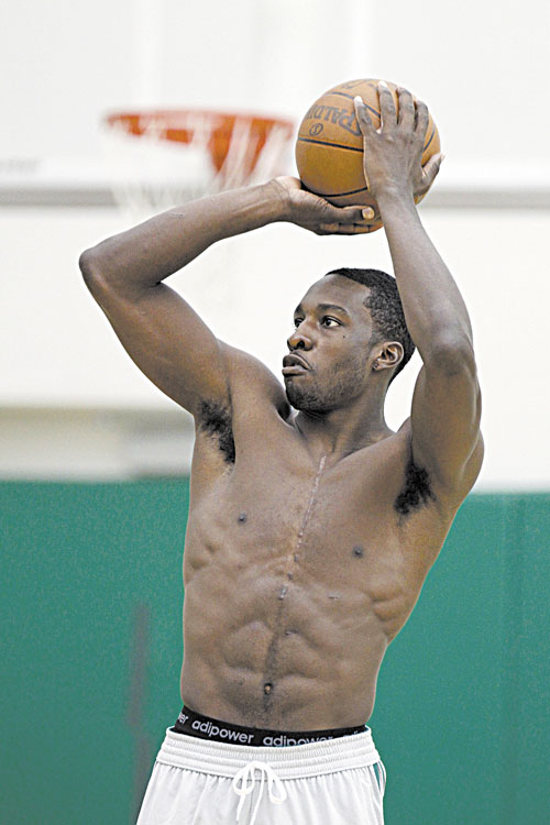 BACK IN ACTION: Boston's Jeff Green shoots during practice Saturday at the team's training facility in Waltham, Mass. After missing all of last season after undergoing heart surgery.