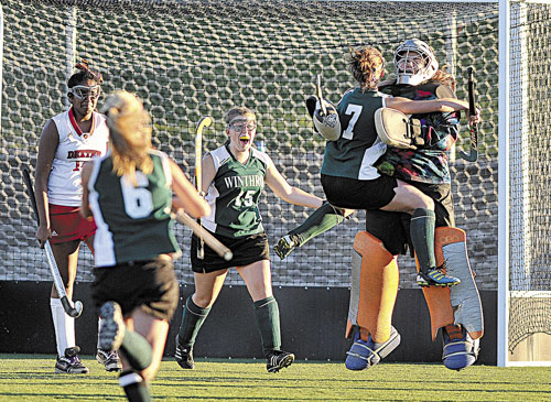 BIG WIN: Winthrop celebrates its 1-0 victory over Dexter in the Eastern Class C championship game Tuesday in Hampden.