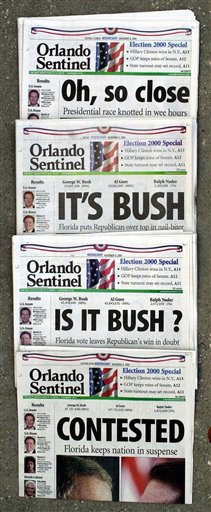 "FILE - This Nov. 8, 2000 file photo shows Orlando Sentinel election night headlines The first headline was, ""Oh, so close,"" followed by ""IT'S BUSH,"" then ""IS IT BUSH?"" and lastly ""CONTESTED."" The presidential election is still undecided while the nation waits for Florida's final vote count. The mere mention of the 2000 election unsettles people in Palm Beach County. The county�s poorly designed �butterfly ballot� confused thousands of voters, arguably costing Democrat Al Gore the state, and thereby the presidency. Gore won the national popular vote by more than a half-million ballots. But George W. Bush became president after the Supreme Court decided, 5-4, to halt further Florida recounts, more than a month after Election Day. Bush carried the state by 537 votes, enough for an Electoral College edge, and the White House. (AP Photo/Peter Cosgrove, File)"