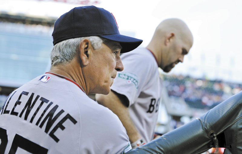 NO LONGER HERE: Bobby Valentine, left, was fired Thursday after leading the Red Sox to a 59-93 record in his first season with the team. Valentine questioned former Red Sox third baseman Kevin Youkilis's desire early in the season, before Youkilis was traded to the Chicago White Sox.