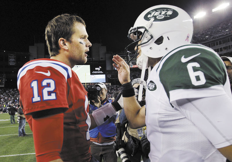 WE'LL TAKE IT: Tom Brady, left, and the New England Patriots beat Mark Sanchez and the New York Jets 29-26 in overtime Sunday but struggled in all three phases of the game. NFLACTION12; Gillette Stadium