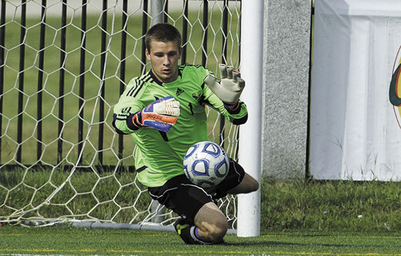 GOOD HANDS: Erskine Academy graduate Brian Potter has a 0.60 goals against average and an .875 save percentage along with four shutouts in 10 games for Husson University this season. Best Shots Husson mens soccer Husson university Husson v UMass Boston eagles fall 2012
