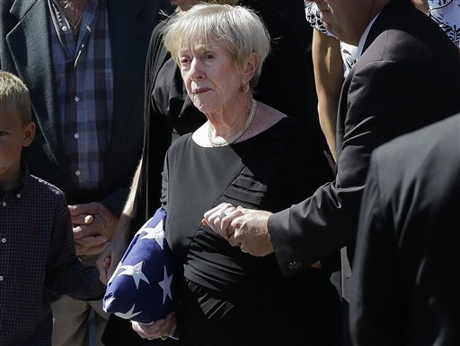 This photo taken Sept. 19, 2012 shows Barbara Doherty, mother of slain former Navy SEAL Glen Doherty, escorted from the Church of St. Eulalia in Winchester, Mass., after his funeral. What do a Navy mom, Big Bird and AARP have in common? They all want President Barack Obama and Republican Mitt Romney to leave them alone. The two candidates are drawing on personal stories and pop culture references in campaign ads, daily speeches and debate zingers as each seeks to cast himself as an �everyman� and broaden his appeal in the presidential race's closing weeks. But they're encountering resistance at seemingly every turn by a broad collection of people they mention and entities they reference. And this year, the complaints go beyond those that usually occur during campaign years: griping by musical groups whose songs candidates use at rallies. (AP Photo/Elise Amendola)