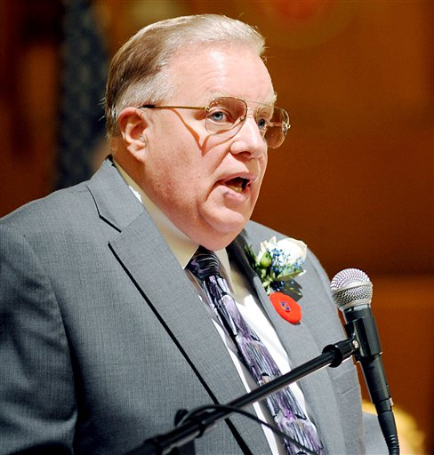"In a Jan. 2, 2012 photo, Lewiston Mayor Robert MacDonald gives his inaugural address at the Franco-American Heritage Center in Lewiston, Me. MacDonald is drawing criticism for remarks he made in a radio interview about Somali refugees in his city. He told the British Broadcasting Corp. this month that immigrants are costing the city a lot of money and that they should ""accept our culture and leave your culture at the door."" (AP Photo/The Lewiston Sun-Journal, Daryn Slover) mayor;robert macdonald"