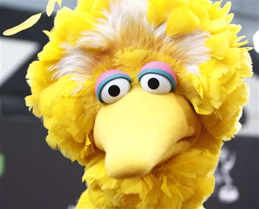 FILE - In this Aug. 30, 2009 file photo, Big Bird arrives at the Daytime Emmy Awards in Los Angeles. What do a Navy mom, Big Bird and AARP have in common? They all want President Barack Obama and Republican Mitt Romney to leave them alone. The two candidates are drawing on personal stories and pop culture references in campaign ads, daily speeches and debate zingers as each seeks to cast himself as an �everyman� and broaden his appeal in the presidential race's closing weeks. But they're encountering resistance at seemingly every turn by a broad collection of people they mention and entities they reference. And this year, the complaints go beyond those that usually occur during campaign years: griping by musical groups whose songs candidates use at rallies. (AP Photo/Matt Sayles, File)