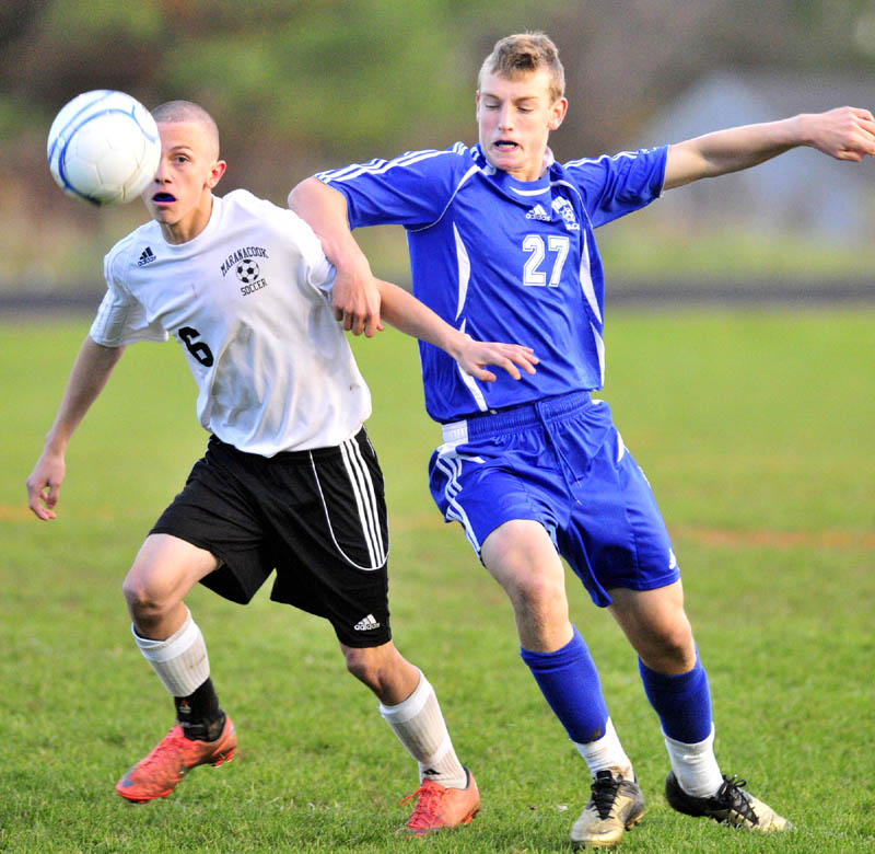GET BACK HERE: Maranacook's Kody Solmitz, left, and Yarmouth's Hugh Grygiel battle for the ball during a playoff game Saturday evening at the Ricky Gibson Field of Dreams at Maranacook Community School in Readfield.