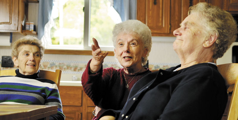 Staff photo by Andy Molloy MEMORY LANE: Sisters Christine Dupuis, right, Lorraine Danforth and Edna Doyon recalled growing up in Augusta in the 1950s during an interview in Belgrade.