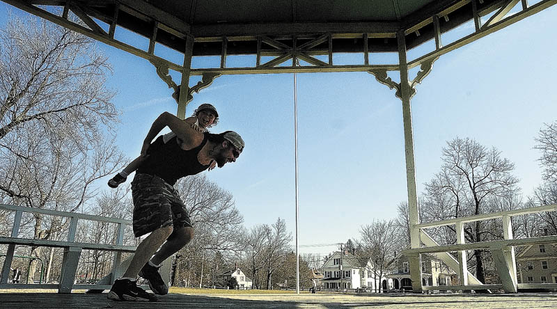 Staff photo by Joe Phelan This March 2012 file photo shows Michael McLaughlin giving his son a piggy-back ride around the gazebo on the common in Gardiner.
