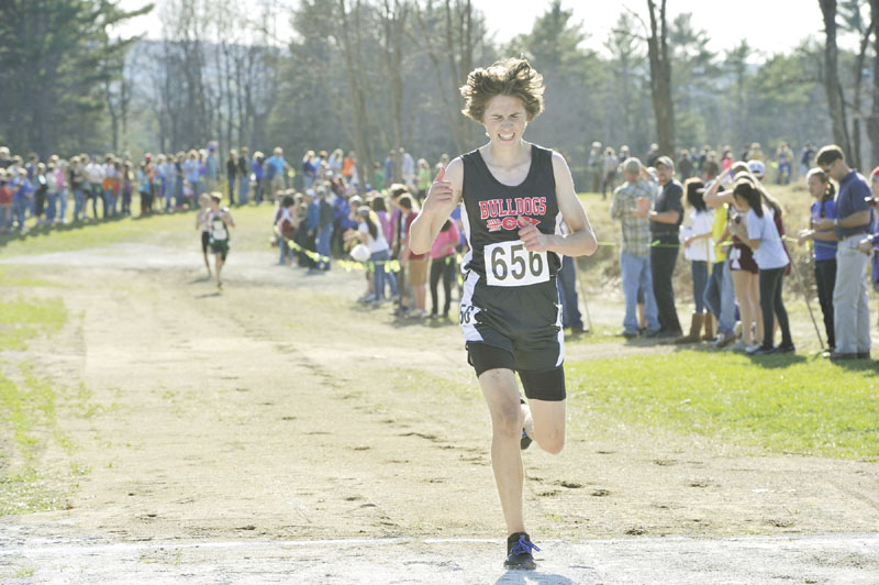 LEADING THE WAY: Hall Dale's Josh Ringer finished eight in a time of 17 minutes, 34.80 seconds to lead the Bulldogs to the Class C cross country state championship Saturday in Belfast.