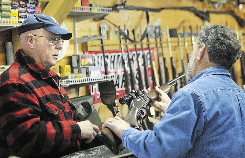 Staff photo by Joe Phelan Owner Gary Hamilton, left, chats with Ted Seney, of Vassalboro, about scopes and ammunition on Thursday afternoon at Neilsen's Sporting Goods in Farmingdale. Seney said that he was getting ready for firearms deer hunting season which opens this Saturday for Maine residents only. The season runs from Monday October 29 to Saturday November 24th.